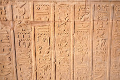 Hierogliphic scripts. Engraved on a wall Royalty Free Stock Image