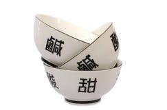 Hieroglyph. Three tea cups on white background Stock Photography
