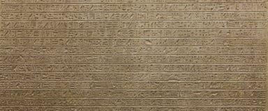 Hieroglyph background. Egyptian hieroglyph on limestone, 1500-1200 BC Royalty Free Stock Image