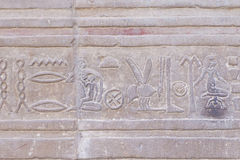 The hieroglyph carved in sandstone Royalty Free Stock Image