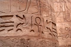Hieroglyph on the column. Ancient Karnak Temple is  first fabulous touristic place in Egypt Royalty Free Stock Photo