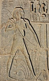 Hieroglyph of a Farmer. A hieroglyph of a farmer from the Temple of Luxor in Egypt royalty free stock images