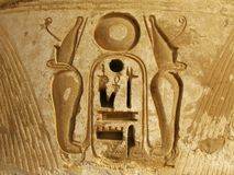 Hieroglyph of pharaoh's cartouche, Medinet Habu. Luxor: hieroglyph of pharaoh's cartouche with two cobras representing the pharaoh, in Medinet Habu temple royalty free stock photo