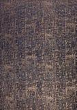 Hieroglyph texture closeup. Egyptian golden hieroglyph texture closeup on dark blue paper. Grunge paper with hieroglyphics from Egypt with magnifier closeup Stock Photography