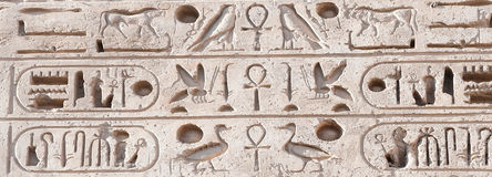 Hieroglyph writing in Medinet Habu, Luxor Royalty Free Stock Photography
