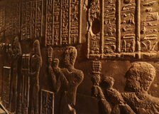 Hieroglyphic carvings in ancient egyptian temple Stock Images