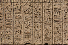 Hieroglyphic carvings in ancient egyptian temple. Hieroglyphic carvings on the exterior walls of an ancient egyptian temple Stock Photo