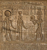 Hieroglyphic carvings in ancient egyptian temple. Hieroglyphic carvings on the exterior walls of an ancient egyptian temple Royalty Free Stock Image