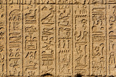 Hieroglyphic carvings in ancient egyptian temple. Hieroglyphic carvings on the exterior walls of an ancient egyptian temple Stock Photography