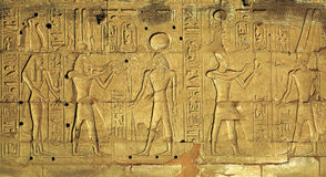 Hieroglyphic carvings in ancient egyptian temple. Hieroglyphic carvings on the exterior walls of an ancient egyptian temple Stock Image