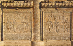 Hieroglyphic carvings in ancient egyptian temple. Hieroglyphic carvings on the exterior walls of an ancient egyptian temple Stock Photos