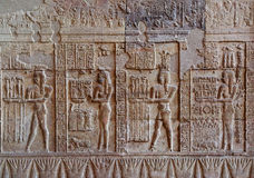 Hieroglyphic carvings in ancient egyptian temple. Hieroglyphic carvings on the exterior walls of an ancient egyptian temple Royalty Free Stock Images