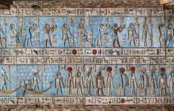 Hieroglyphic carvings in ancient egyptian temple. Hieroglyphic carvings and paintings on the interior walls of an ancient egyptian temple in Dendera Royalty Free Stock Photo