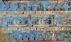 Hieroglyphic carvings in ancient egyptian temple. Hieroglyphic carvings and paintings on the interior walls of an ancient egyptian temple in Dendera Stock Photo
