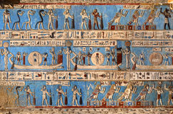 Hieroglyphic carvings in ancient egyptian temple. Hieroglyphic carvings and paintings on the interior walls of an ancient egyptian temple in Dendera Royalty Free Stock Photos