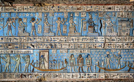 Hieroglyphic carvings in ancient egyptian temple. Hieroglyphic carvings and paintings on the interior walls of an ancient egyptian temple in Dendera Stock Image