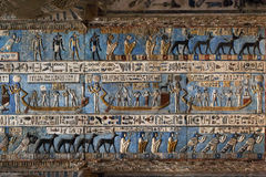 Hieroglyphic carvings in ancient egyptian temple. Hieroglyphic carvings and paintings on the interior walls of an ancient egyptian temple in Dendera Royalty Free Stock Image