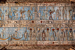 Hieroglyphic carvings in ancient egyptian temple. Hieroglyphic carvings and paintings on the interior walls of an ancient egyptian temple in Dendera Royalty Free Stock Images