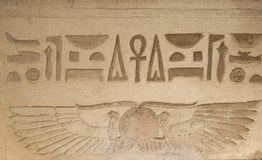 Hieroglyphic carvings on an ancient egyptian temple wall royalty free stock photo