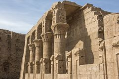 Hieroglyphic carvings on an ancient egyptian temple wall with co royalty free stock images