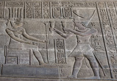 Hieroglyphic carvings on an ancient egyptian temple wall Royalty Free Stock Images
