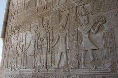 Hieroglyphic carvings on an ancient egyptian temple wall stock image