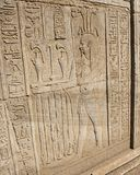Hieroglyphic carvings on an ancient egyptian temple wall stock images