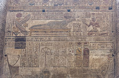 Hieroglyphic carvings on an ancient egyptian temple wall Stock Photos