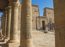 Hieroglyphic carvings on columns and wall at entrance to an ancient egyptian temple royalty free stock photos