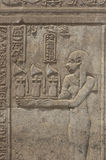 Hieroglyphic carvings on an Egyptian temple wall Stock Image