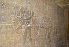 Hieroglyphic carvings in an Egyptian temple wall Stock Photo