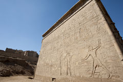 Hieroglyphic carvings on an egyptian temple wall Royalty Free Stock Images