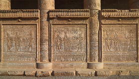 Hieroglyphic carvings on the exterior walls of an ancient egypti Stock Image