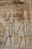 Hieroglyphic carvings on the exterior walls of  egyptian temple. Hieroglyphic carvings on the exterior walls of egyptian temple Royalty Free Stock Photography