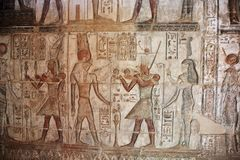 Hieroglyphic carvings and painting. S on the interior walls of the temple Stock Photos