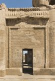 Hieroglyphic carvings on wall at entrance to an ancient egyptian royalty free stock photography