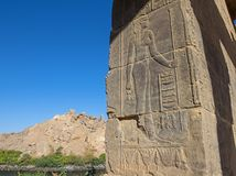 Hieroglyphic carvings on wall at window in an ancient egyptian temple royalty free stock images