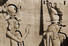 Hieroglyphic. Carvings in the walls at of an Egyptian ancient temple.Early Hieroglyphs were logograms representing words using graphical figures such as animals stock photo