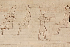 Hieroglyphic. Carvings in the walls at of an Egyptian ancient temple.Early Hieroglyphs were logograms representing words using graphical figures such as animals stock image