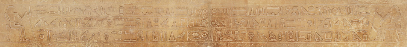 Hieroglyphic on stone. Hieroglyphic on wall stone in egyptian temple Royalty Free Stock Photography