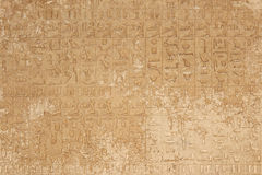 Hieroglyphic on stone. Hieroglyphic on wall stone in egyptian temple Royalty Free Stock Image