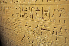 Hieroglyphic writing in sandtone Royalty Free Stock Photo