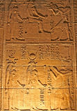 Hieroglyphics. On the wall in the Temple of Philae at Aswan, Egypt (Low light photography Royalty Free Stock Image
