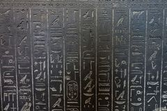 Hieroglyphics Close-Up. Close-up of ancient Egyptian hieroglyphics carved on granite slabs on display at the British Museum of London Stock Photos