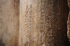 Hieroglyphics. Hieroglyph written on a stone column Stock Images