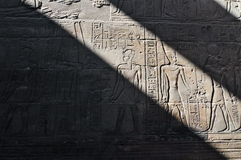 Hieroglyphics masked in light in shadow at Luxor Temple. Stock Photography