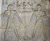 Hieroglyphics on a wall. Hieroglyphic carvings on a wall at Luxor Temple Stock Photography