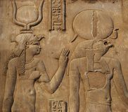 Hieroglyphics on the wall of an Egyptian temple stock photography