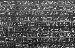 Hieroglyphs. A beautiful wall covered with beautiful hieroglyphs that recall the ancient history of Egypt with the contrast of white and black is a beautiful Stock Photos