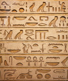 Hieroglyphs on the wall Stock Images